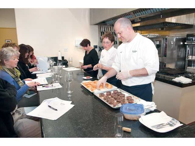 Culinary Wonders' owners and Le Cordon Bleu Chefs, Herve Guillard, right, and Judy Gilbert, lead a class.