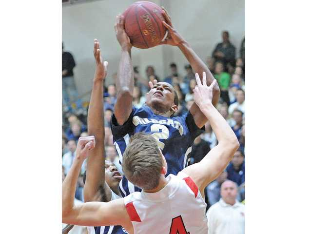 West Ranch's Ben Johnson (2) shoots against Hart defender Andrew MacArthur (4) at Hart High on Tuesday.