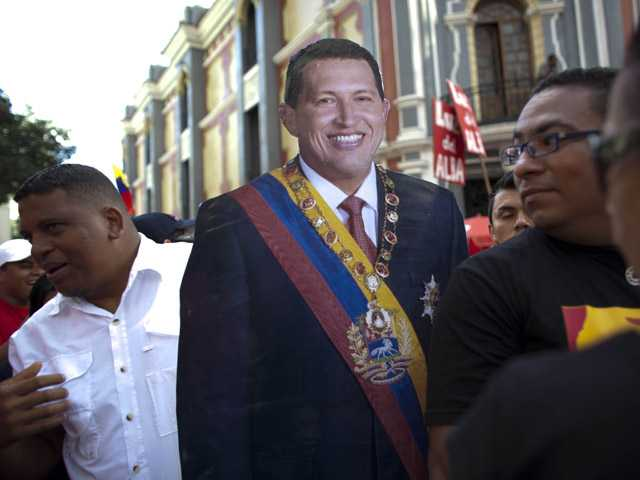 A life-size cut out image of Venezuela's President Hugo Chavez is carried by a Chavez supporter during a symbolic inauguration ceremony.