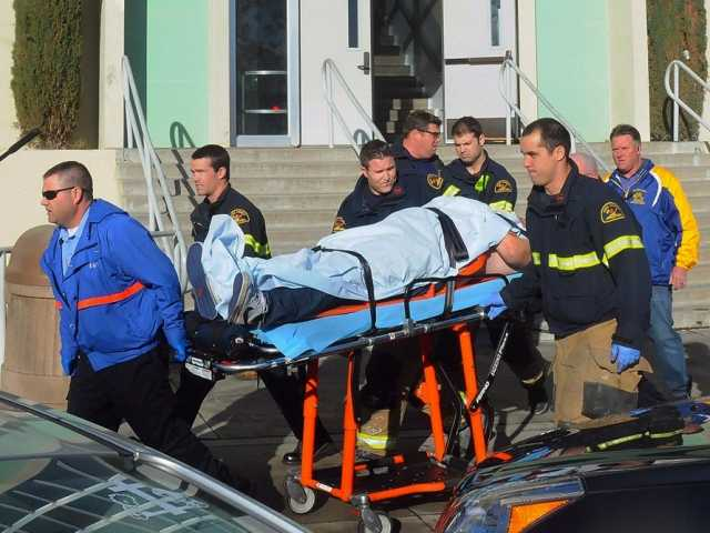 This image provided by the Taft Midway Driller/Doug Keeler shows paramedics transporting a student wounded during a shooting Thursday at San Joaquin Valley high school in Taft, Calif.