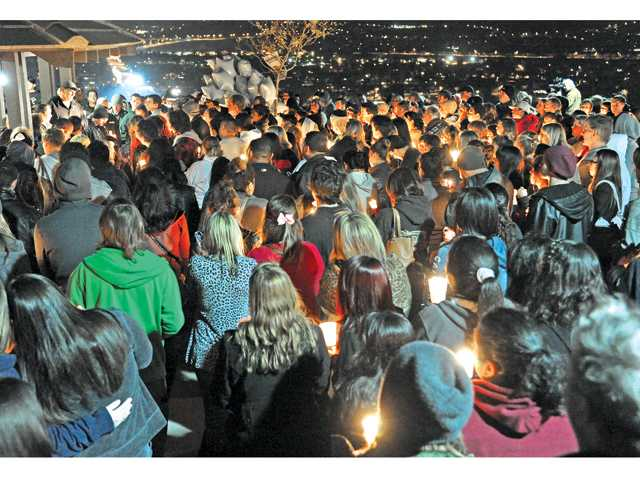 Mike Alarid, top, left, father of Sarah Alarid, thanks hundreds of friends, family and volunteers for their support in looking for his missing daughter over the past few days as they gather at a candlelight vigil held at Todd Longshore Park overlooking Canyon Country on Wednesday evening.