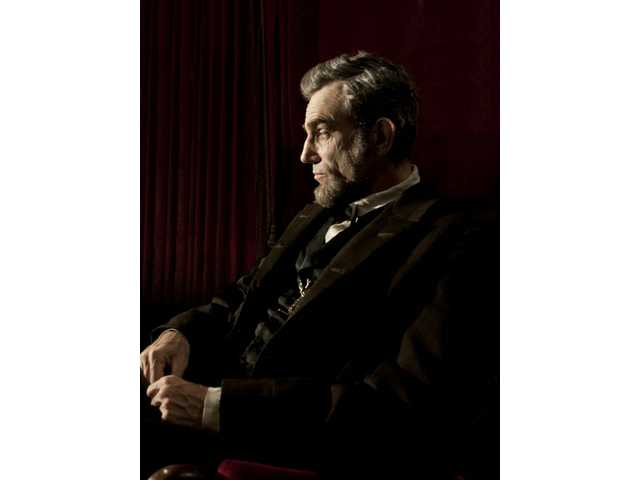 "Daniel Day-Lewis portrays Abraham Lincoln in the film ""Lincoln."""