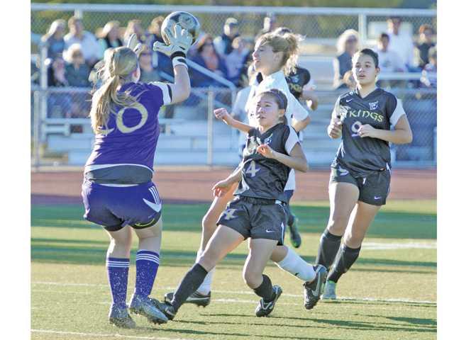 Valencia goalkeeper Nicole Joseph (20), left, blocks a shot by Saugus' Emily Orr, background center, on Tuesday at Saugus High.