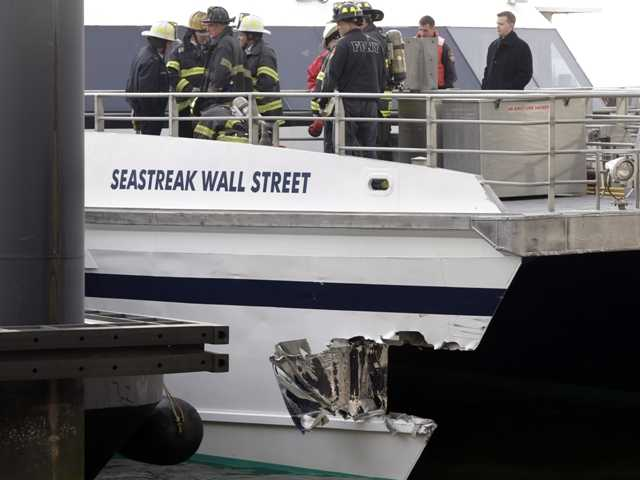 New York City firefighters on the deck of the Seastreak ferry in New York, Wednesday. The ferry banged into the mooring as it in lower Manhattan, injuring as many as 50 people.