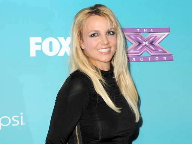 "A person familiar with plans for Fox's ""The X Factor"" says singer and celebrity judge Britney Spears is out of the show."