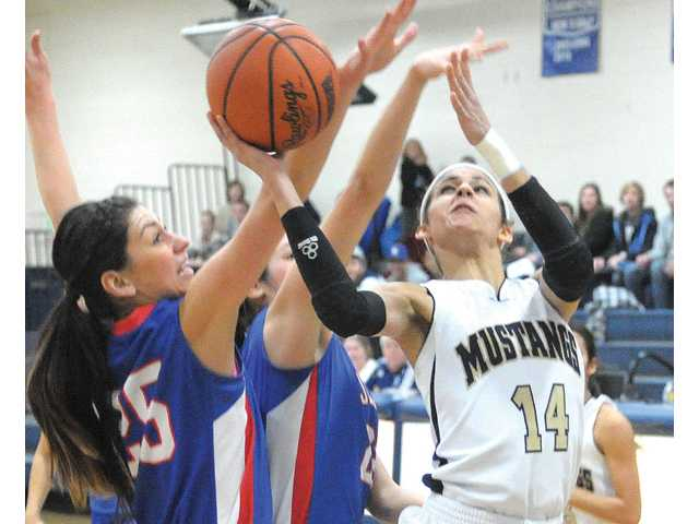The Master's College senior Lena Rivera (14) shoots against William Jessup's Alexandria Westsbrook on Dec. 15.
