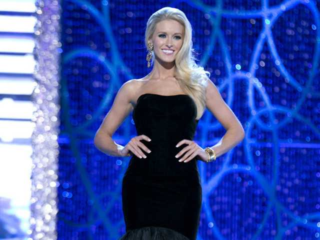 This photo shows Miss DC, Allyn Rose, during the Evening Wear portion of preliminary competition at the 2013 Miss America Pageant in Las Vegas, Tuesday.