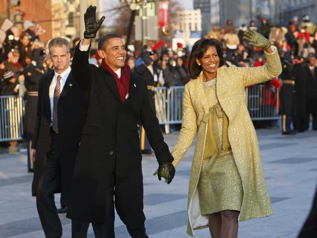 In this Jan. 20, 2009, file photo, President Barack Obama and first lady Michelle Obama walk the inaugural parade route in Washington.