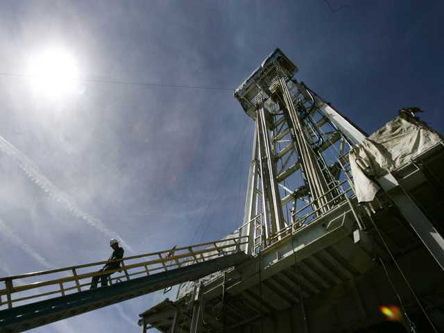 In this May 16, 2008, file photo, a worker steps down from the drilling platform at Newberry Crater near LaPine, Ore.