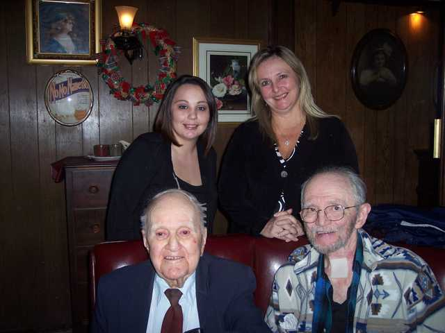 Robert Shedd, bottom right, along with family and friends, celebrated his 100th birthday at The Backwoods Inn in Canyon Country on Dec. 9. Four generations gathered to celebrate in a special birthday photo including Shedd's son Don, granddaughter Stacie and great-grandaughter Amber. Unable to attend was Kiarra, his great-great-granddaughter.