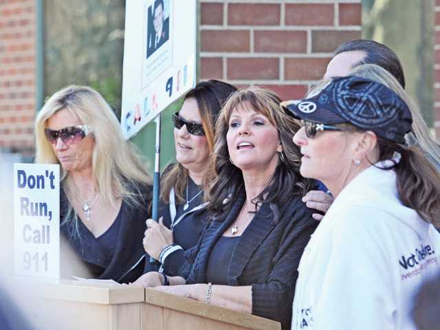 Krissy McAfee, second right, speaks as she joins a group of mothers who lost children to drug overdoses as they participate in the Good Samaritan Walk on Saturday in Valencia to raise awareness for California's new Good Samaritan overdose prevention law.