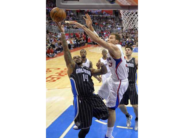 Orlando Magic guard Jameer Nelson, left, goes up for a shot as Los Angeles Clippers forward Blake Griffin defends Saturday in Los Angeles.