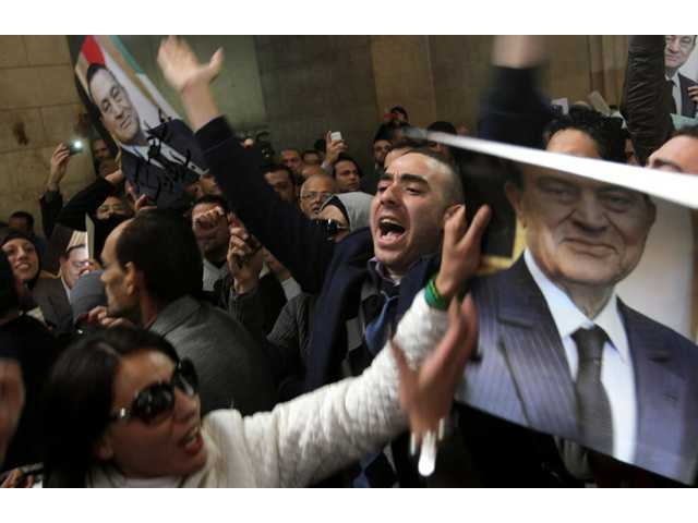 Egyptians supporters of ousted former President Hosni Mubarak celebrate an appeal granted by a court in Cairo.