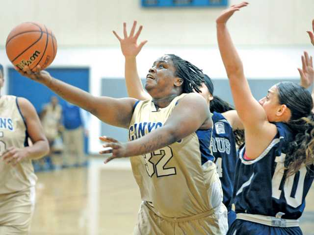 Keiona Mathews (32) shoots and scores against Citrus' Sarah Rebibo (10) at COC on Saturday.