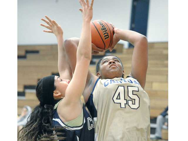 Hope Smith (45) shoots and scores against Nicole Zugasti (24)  of Citrus College at College of the Canyons on Saturday. COC won 68-54.