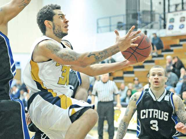 Terrez Scott (30) puts College of the Canyons ahead of Citrus College in overtime at COC on Saturday. The Cougars went on to win 81-77.