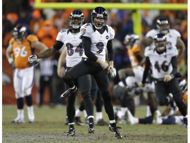 Baltimore Ravens kicker Justin Tucker (9) reacts after hitting the winning field goal against the Denver Broncos in overtime Saturday in Denver. The Ravens won 38-35.