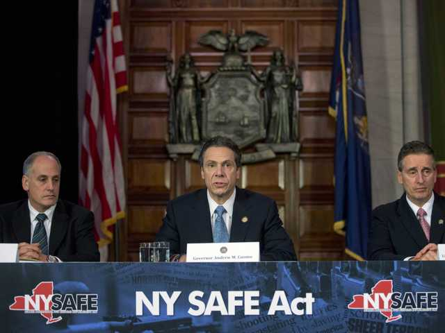 New York Gov. Andrew Cuomo, center, speaks on an agreement with legislative leaders on New York's Secure Ammunition and Firearms Enforcement Act on Monday, in Albany, N.Y.