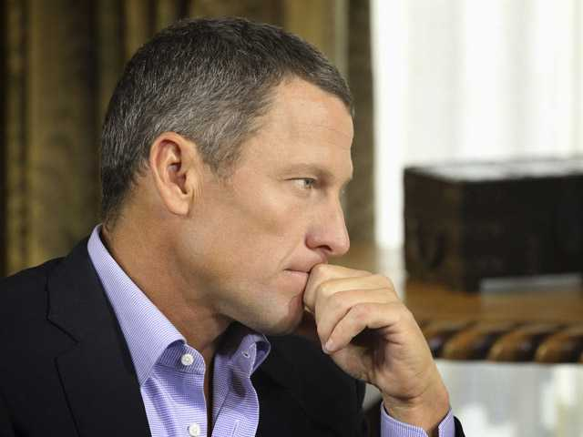 "Lance Armstrong listens to a question from Oprah Winfrey during taping for the show ""Oprah and Lance Armstrong: The Worldwide Exclusive."""