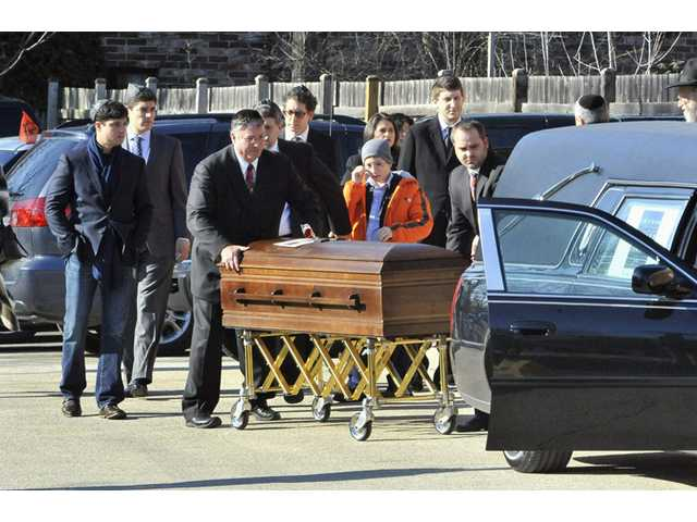 Swartz father blames 'government' at son's funeral