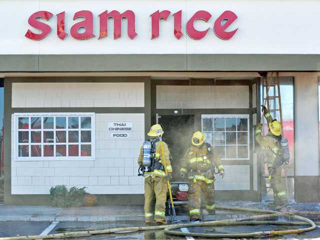Firefighters work the scene of a fire at a strip mall at Soledad Canyon Road and Sierra Highway in Canyon Country on Tuesday.