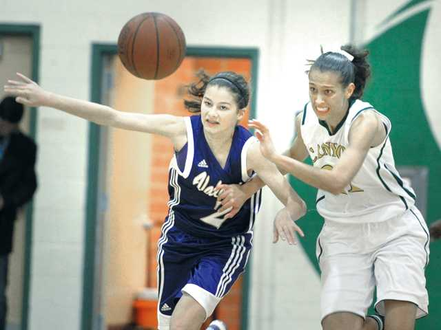 Valencia's Sabrina Thompson (2) and Canyon's Jaya Schultz (21) fight for a loose ball at Canyon on Tuesday.