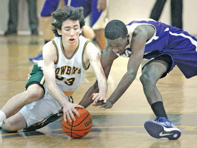 Canyon's Steven Brotz (33), left, and Valencia's Jaleel Howard (12) fight for a loose ball during Tuesday's game at Canyon High School.