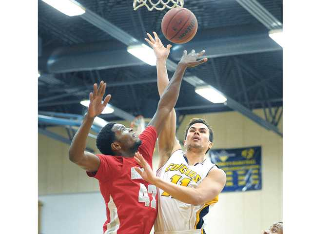 COC's David Horst (11) and Bakersfield's Taevawne Morrison (42) fight for a rebound at COC on Wednesday.