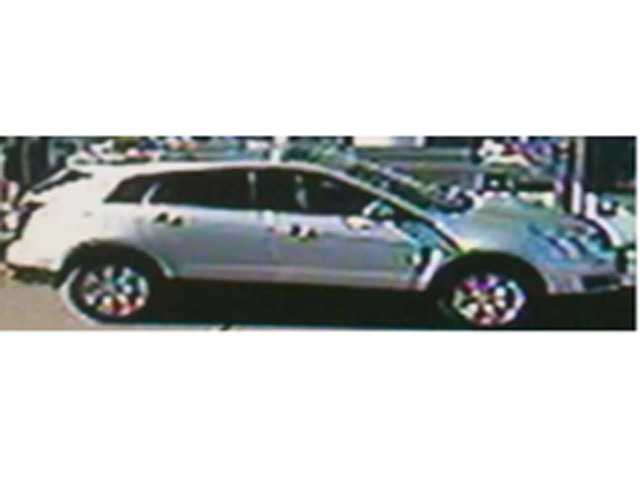 The suspected thief is believed driving a silver Cadillac SUV shown here in a surveillance image.