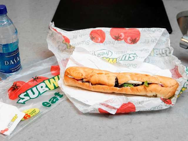 Subway, the fast food chain,is facing criticism after an Australian man posted a picture inJanuary next to a tape measurethat seems to shows the sandwich isnot as long as promised.