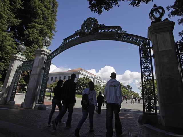 In this June 1, 2011 file photo a group of students walk through the Sather Gate on the University of California, Berkeley campus in Berkeley.