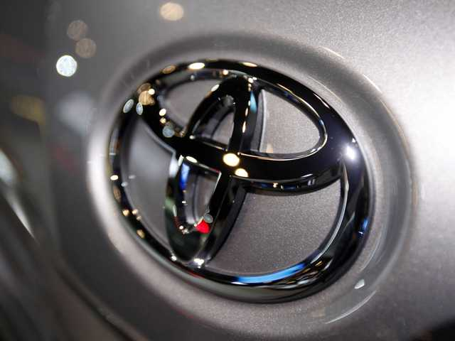 This March 31, 2010 file photo shows the Toyota logo on a car at the New York International Auto Show in New York. (AP)