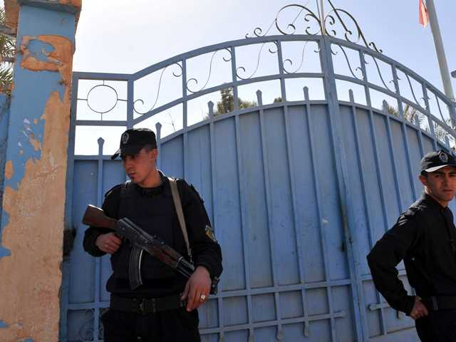 Algerian special police unit officers secure the hospital in Ain Amenas, Algeria, Friday, Jan. 18, 2013, two days after terrorists attacked foreign workers at a gas plant and took hostages.