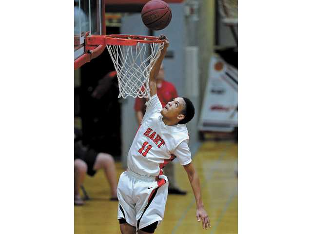 Hart's Myles Franklin dunks the ball during the Indians' victory over Valencia at Hart High School on Friday.