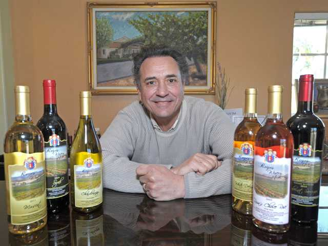 Robert Reyes, founder of Reyes Winery in Agua Dulce with a few of the 13 different wines he crafts. His wines have won18 medals and awards.