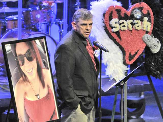 Sarah Alarid's father,  Mike, speaks about her during her memorial service held at Real Life Church in Valencia on Saturday.