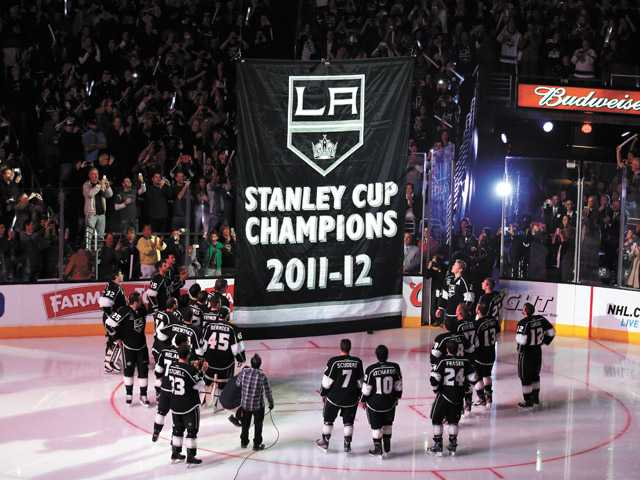 The Los Angeles Kings watch as the Stanley Cup championship banner is raised before the Kings' 5-2 loss to Chicago in Los Angeles on Saturday.