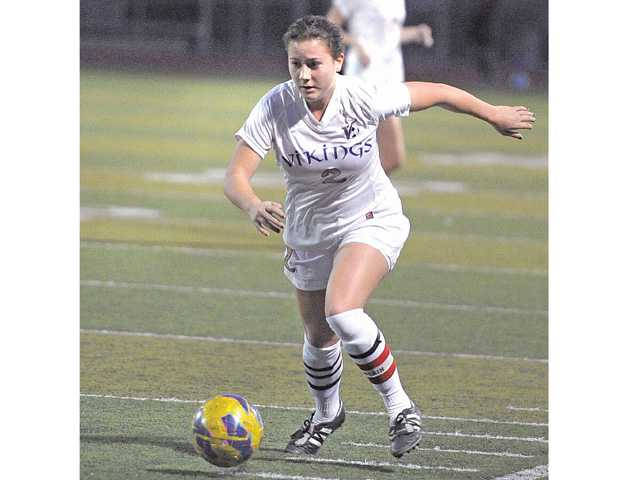 Valencia senior Lindsay Bos moves up field with the ball against Hart on Friday night at Valencia. The Vikings tied 1-1 with the Indians and remain a half-game back of first.