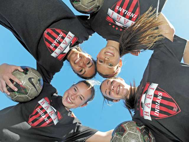 Hart soccer players, clockwise from lower left, Hailey Jenkins, Ally Perez, Presley Lambert and McKinley Kane have helped the Indians to a 3-0-1 league record and are unbeaten in their last 12 matches.