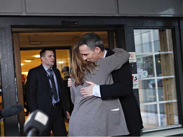 Norway's Prime Minister Jens Stoltenberg is embraced by Executive Vice President in Statoil, Margrethe Oevrum, Saturday, after his visit in Bergen for relatives of the Statoil-employees taken hostage in Algeria. (AP)