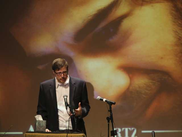 Ben Winkler, a long time friend, speaks during the memorial service for Aaron Swartz, Saturday in New York. (AP)
