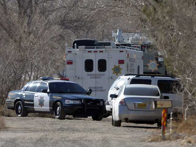 BCSO Deputies and crime scene personnel work the scene of a five person homicide in Albuquerque, NM, Sunday.
