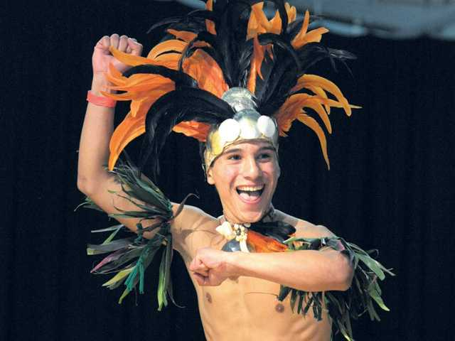 Tahitian drummers on stage provide the rhythm as Christian Cordova, 18, competes in the Tana age 18-24 dance category at the Te Mana Ori Tahitian Solo Dance Competition in Castaic on Saturday. Signal photo by Dan Watson