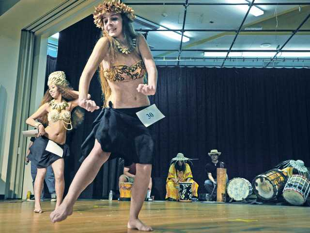 Hana Andersen, left, and Tiffany Pascua compete in the Vahine ages 14-17 category at the Te Mana Ori Tahitian Solo Dance Competition held at Castaic Middle School on Saturday. Signal photo by Dan Watson