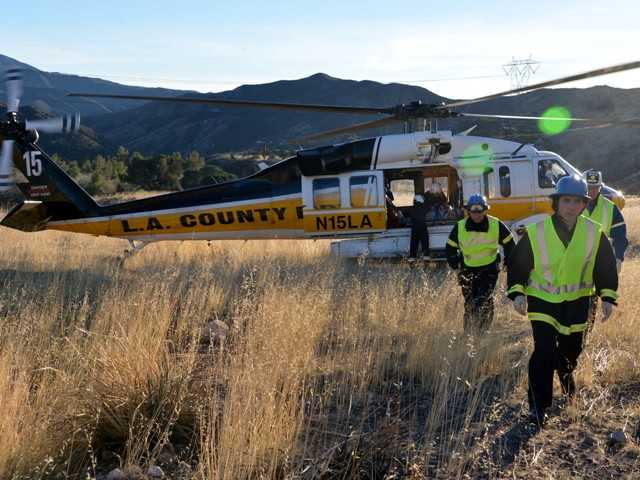 A rescue helicopter was used to take two victims to UCLA Medical Center following a roll-over crash off Highway 14 at Agua Dulce Canyon Road on Monday. Photo by Rick McClure