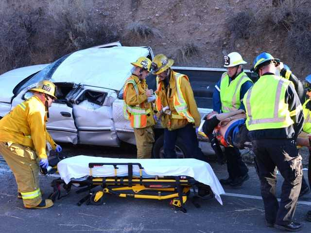 Three people were injured Monday when a Dodge pickup truck rolled off the side of Highway 14 at Agua Dulce Canyon Road. Photo by Rick McClure