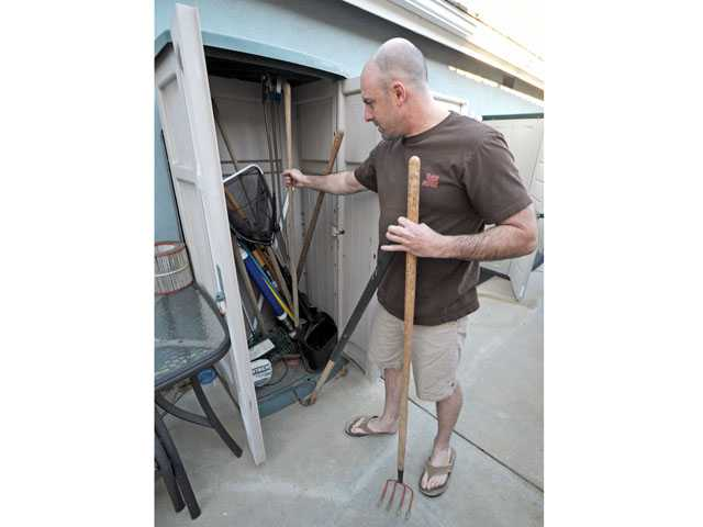 "Dave Collins describes Monday how ""hot prowl"" burglars attempted to pull gardening tools from a storage shed at his Valencia home."