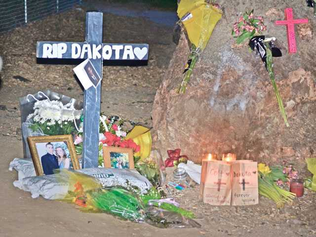 A memorial for Dakota DeMott is seen at the site where he was killed in a crash in 2012.