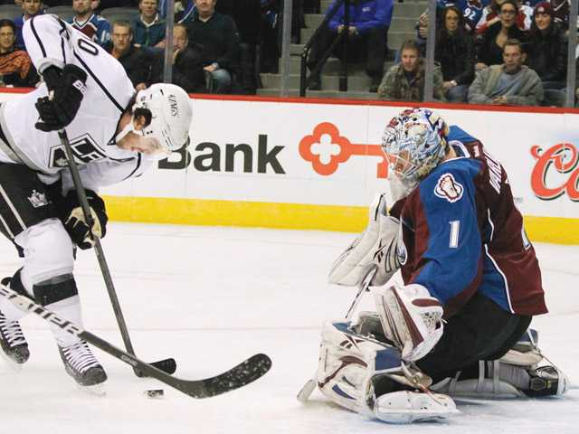 Los Angeles King Mike Richards (10) looks for a shot against Colorado Avalanche goalie Semyon Varlamov during Tuesday's game in Denver. The Kings lost 3-1.