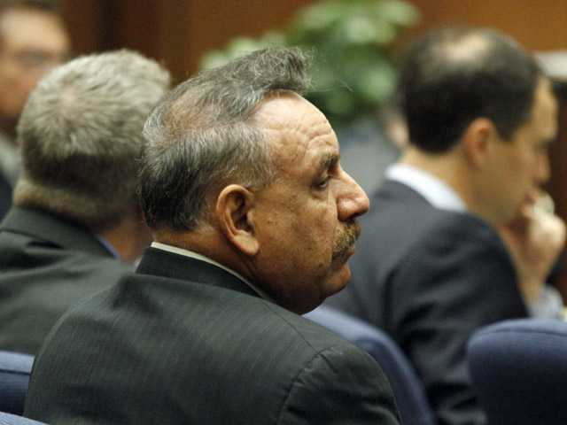 Former Bell, Calif. mayor Oscar Hernandez listens to opening statements in a massive city corruption trial in a downtown Los Angeles courtroom.